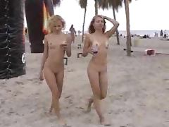 Voyeur cam catches two pretty slim girls on a nude beach