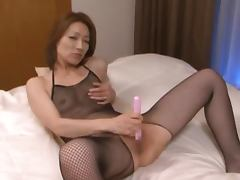 Sexy Japanese babe in fishnet dress gets threesomed
