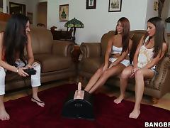 Eli Lizz Tayler and Trinity St Clair test their new toys in the living room