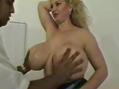 Big breasted mature blonde satisfies a few horny studs