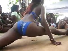 Hot ebony chick strips outdoors and shows her nice boobs to her friends