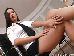 Sweet brunette in office clothes having fun with her dildo