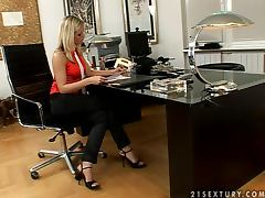 Sexy blonde Wivien plays with her shaved pussy in an office