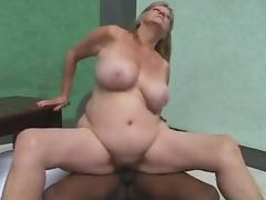Mature blonde lets a hot ebony girl fuck her snatch with a strap on