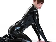 Model in latex catsuit and ballet boots