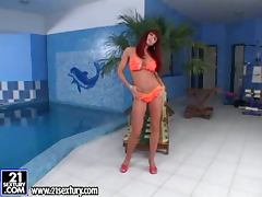Sonya the nasty redhead babe plays with her pussy in indoor pool