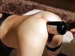 Giant wine bottle stuffed in her gaping asshole porn tube video