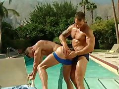 Muscled men at pool 2
