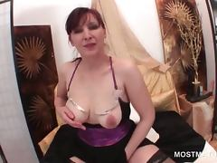 Redhead mature rubbing her cunt and boobs in close up