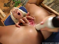 Dorina the lovely blonde fondles her shaved pussy