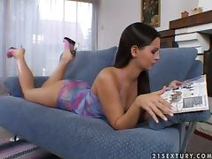 Horny Eve Angel lies in an armchair toying her hot pussy