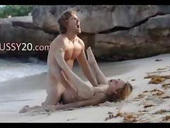 elegant art sex of horny couple on beach