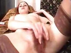 Naughty amateur siren is masturbating her bushy beaver tube porn video