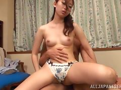 Pretty Japanese girl has wild sex on the eyes of a man