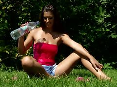 Diana pleases herself with fingering in the garden
