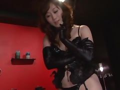 Sexy Japanese girl in latex costume gives a blowjob porn tube video