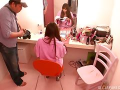 Pretty Japanese girl sucks a cock in a backstage