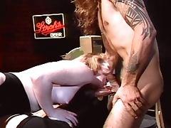 Beautiful redhead fucked in a bar