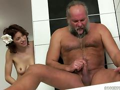 Brigitta gets fucked by an old dude in the bathroom tube porn video