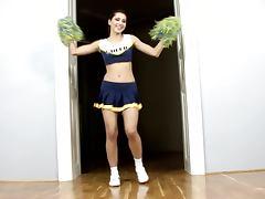 Hot cheerleader Anne finger fucks her juicy cunt indoors