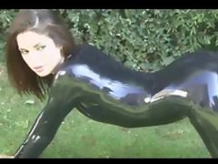 Brunette in black latex catsuit and high heels tube porn video