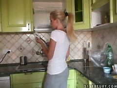 Peaches and Sophie Moone play sweet games in the kitchen tube porn video
