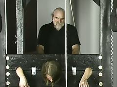 Old guy pounds young brunette with small tits jailed in stocks tube porn video