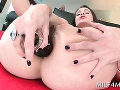 Slutty mom nailing her small butt hole with a fat dildo
