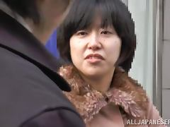 Nasty Japanese lady gives a blowjob in the car