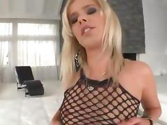 Stockinged blondie gets herself off