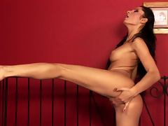 Passionate Lucile toys her pussy in her bedroom