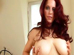Redhead milf Bettie Ballhaus is poking her shaved pussy tube porn video
