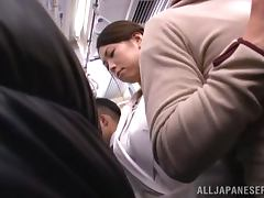 Honey gets naked completely in the public bus tube porn video