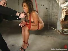 Black chick gets toyed with big dildo and water tortured