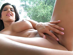 Big titted brunette Sunny Leone demonstrates her shaved pussy
