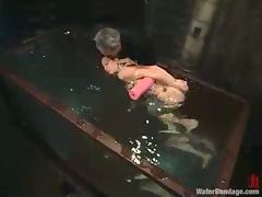Slim blonde girl gets her pussy toyed under water jet