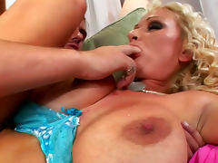 Curly pornstar Sharon Pink gives a blowjob