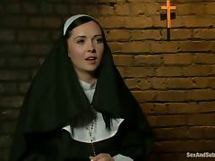 Slutty nun gets tied up and fucked rough by two guys