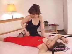 Asian Woman Getting Her Strapon Rubbed Sucking Other Woman Nipples Patting On The Bed In The Bedroo