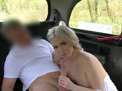 Blonde is giving a blowjob right in the car