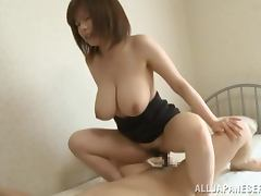 A beautiful big boobed Asian sweetheart gets busy in bed