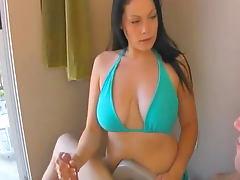 Cute babe in bikini gets a cumshot after handjob