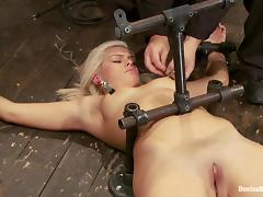 Bonded blonde girl lies on the floor and gets humiliated