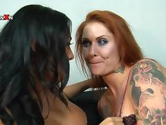 Brunette and redhead girls in hot fisting video