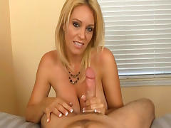 Busty blonde gives a nice titjob on the cam