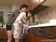 Chubby Japanese housewife gets pounded in a kitchen tube porn video