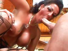 Brunette Anjelica Lauren is giving a blowjob