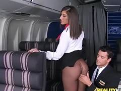 curvy flight attendant sucks a pilot