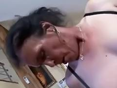 Breasty dark brown granny acquires naughty cunt pounding