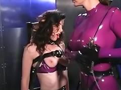 Latex dominatrix punishes captured dark brown porn tube video